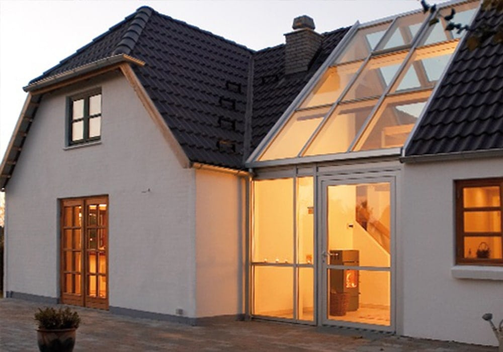 white house with black roof in denmark