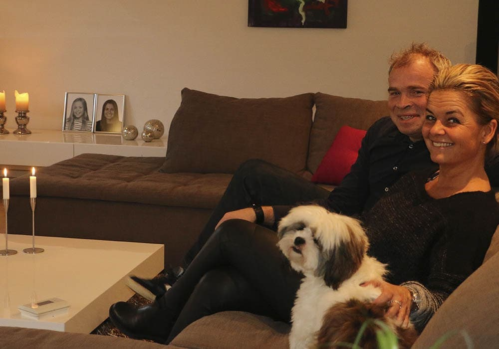 John Damsted with blonde wife and dog